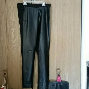 Black polyester pants with 4% spandex back.